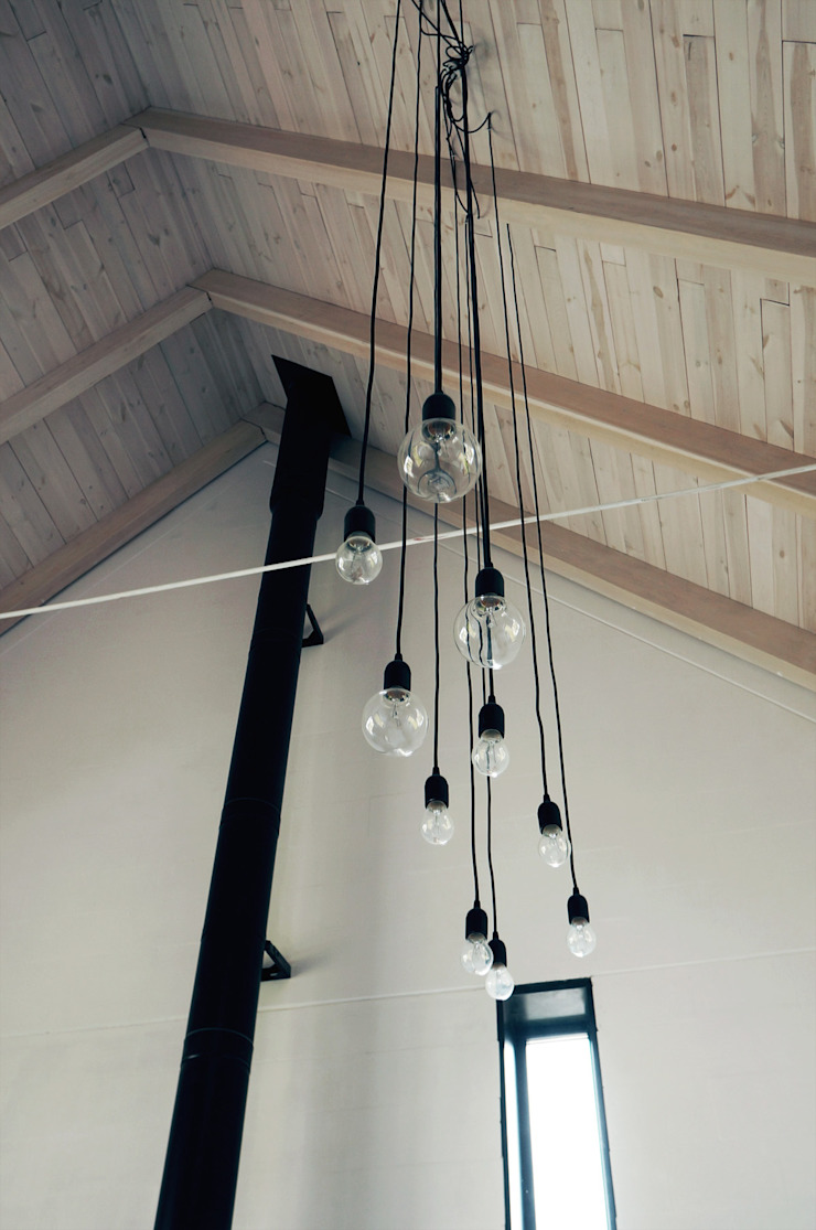 Dom jednorodzinny Industrialny salon od Grid Architekci Industrialny