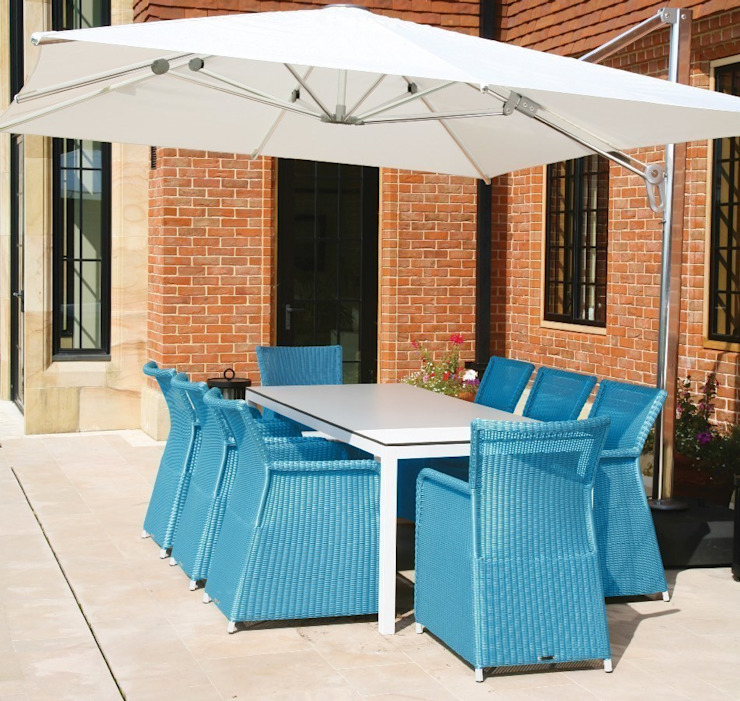 Rattan and Metal garden dining set with blue rattan armchairs and modern, white aluminium and glass table de Ingarden Ltd Moderno