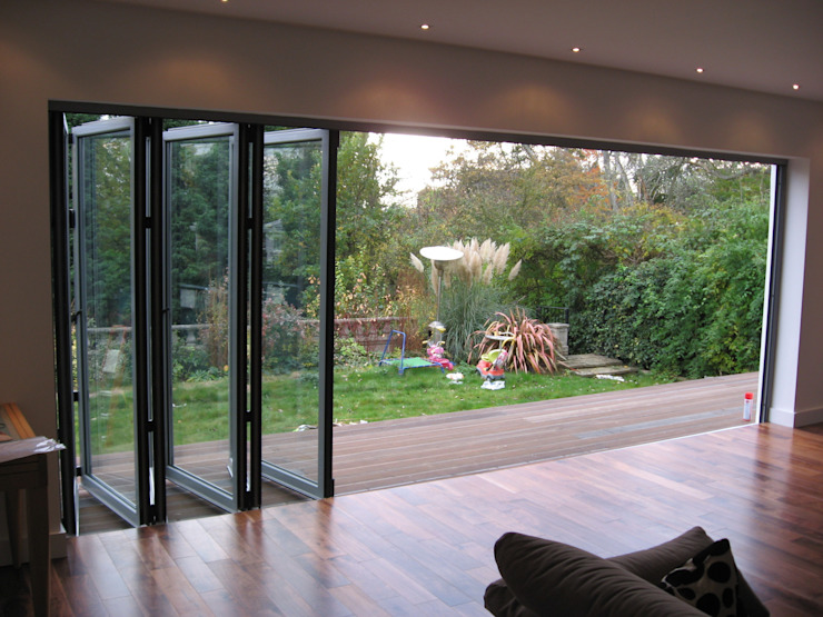 Folding glass doors Modern conservatory by homify Modern