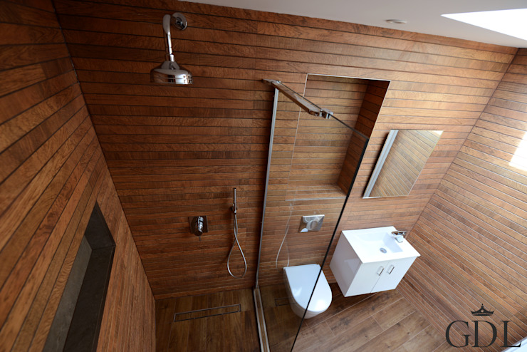 Baños de estilo  por Grand Design London Ltd,