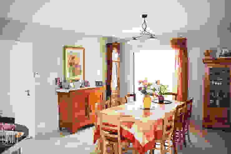 Salas de jantar clássicas por Uniq intérieurs Clássico