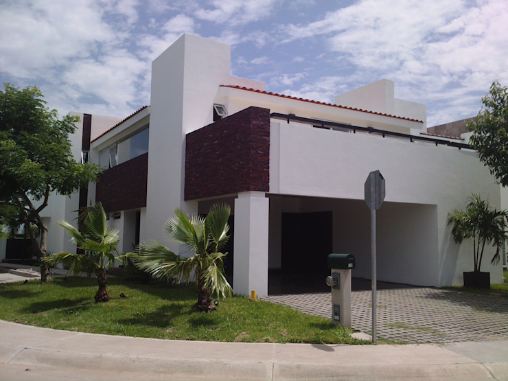 casa 319 Casas modernas de Hussein Garzon arquitectura Moderno Piedra