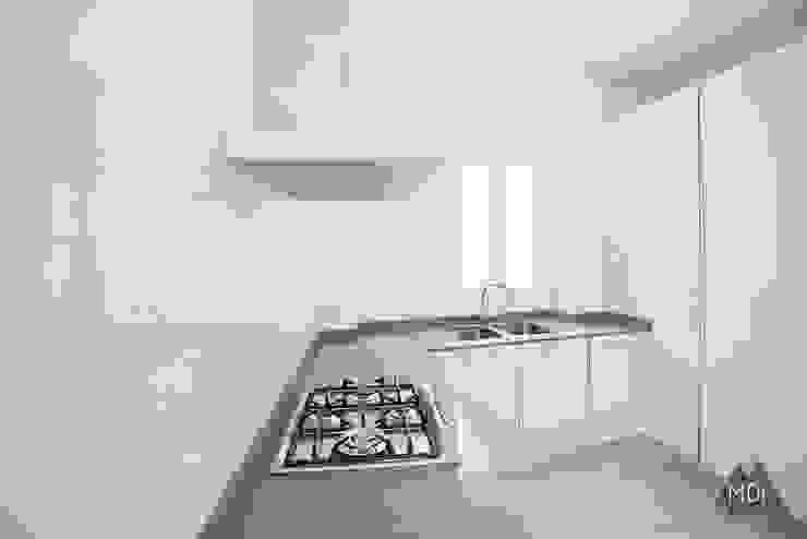 Cocina reforma vivienda Ruzafa (Valencia) Cocinas de estilo moderno de MDF CONSTRUCCION Moderno