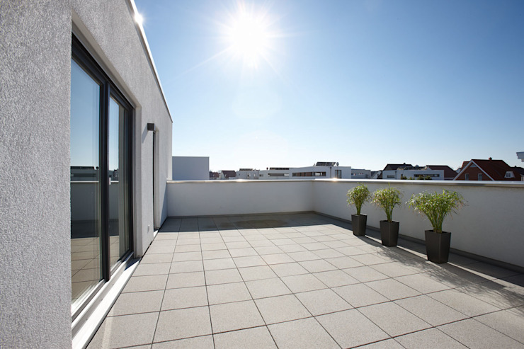 Terrazas de estilo  por FingerHaus GmbH - Bauunternehmen in Frankenberg (Eder)