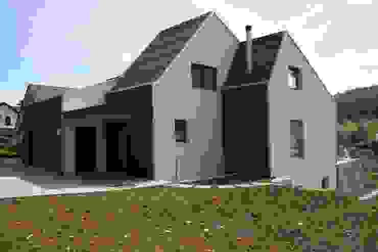 Eingangsfassade Moderne Häuser von wohlgemuth & pafumi | architekten ag Modern