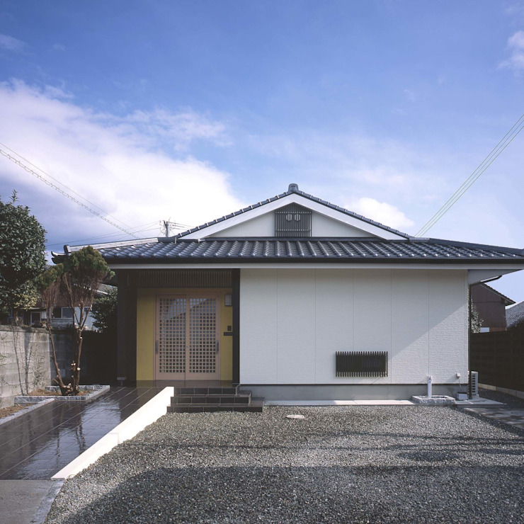 Eclectic style houses by 志賀建築設計室 Eclectic