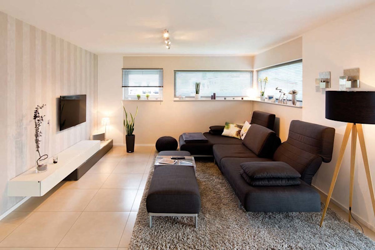 Salas de estar modernas por FingerHaus GmbH - Bauunternehmen in Frankenberg (Eder) Moderno