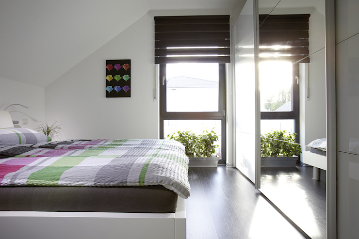 Bedroom by FingerHaus GmbH - Bauunternehmen in Frankenberg (Eder)