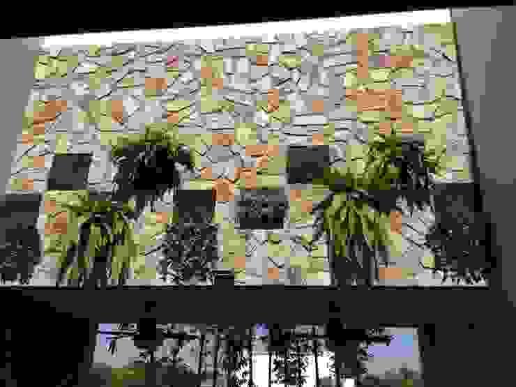 Modern Garden by Hussein Garzon arquitectura Modern Stone