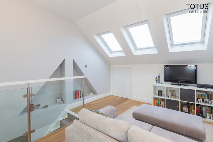 Loft conversion and house remodelling in Wimbledon Modern living room by TOTUS Modern