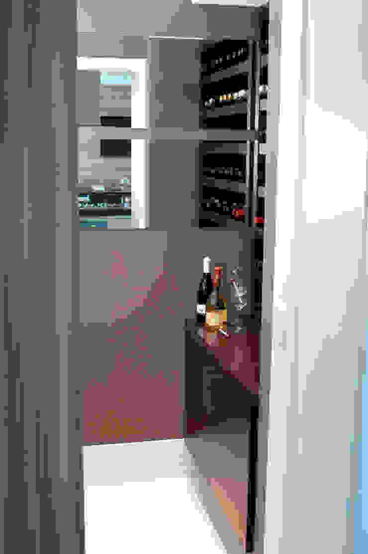 Adega integrada a cozinha/espaço gourmet Adegas modernas por Flavia Caldeira Bruno Arquitetura e Interiores Moderno