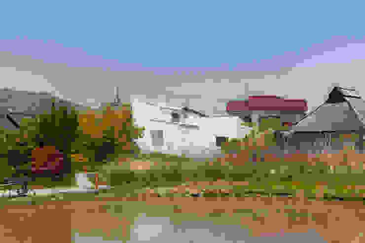 建物遠景 モダンな 家 の 株式会社 T.N.A モダン