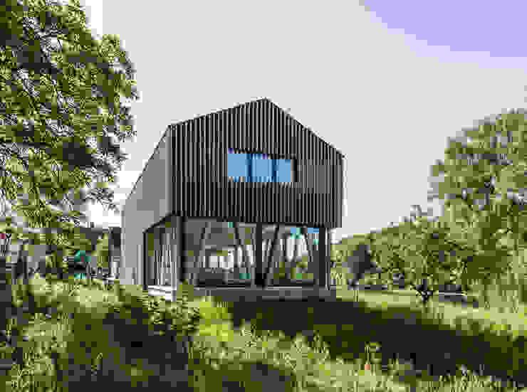 Eingebettet in die Natur Minimalistische Häuser von Dost Minimalistisch