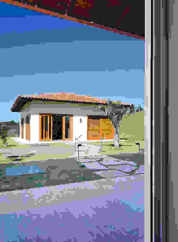NOMA ESTUDIO Casas de estilo rústico