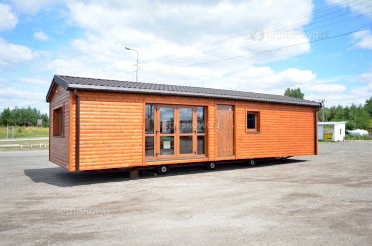 Prefabricated homes: Design ideas, inspiration & pictures by Letniskowo.pl Sp. z o.o. Sp.k. Classic Wood Wood effect