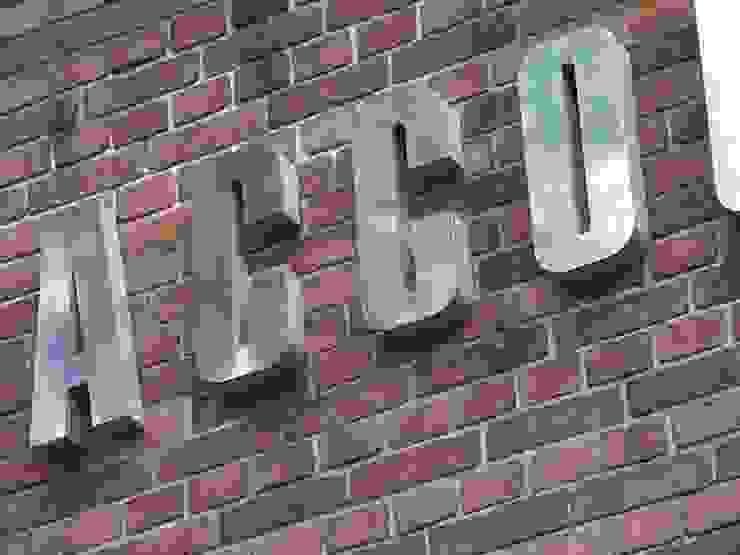 RVS gevelbelettering met doosprofiel-letters Kouwenbergh Machinefabriek B.V. Industriële kantoor- & winkelruimten