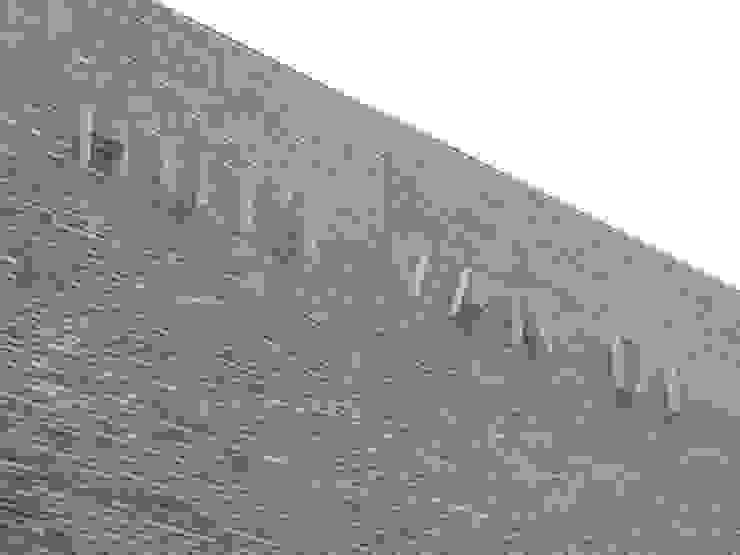 RVS gevelbelettering uit strip Kouwenbergh Machinefabriek B.V. Industriële kantoor- & winkelruimten