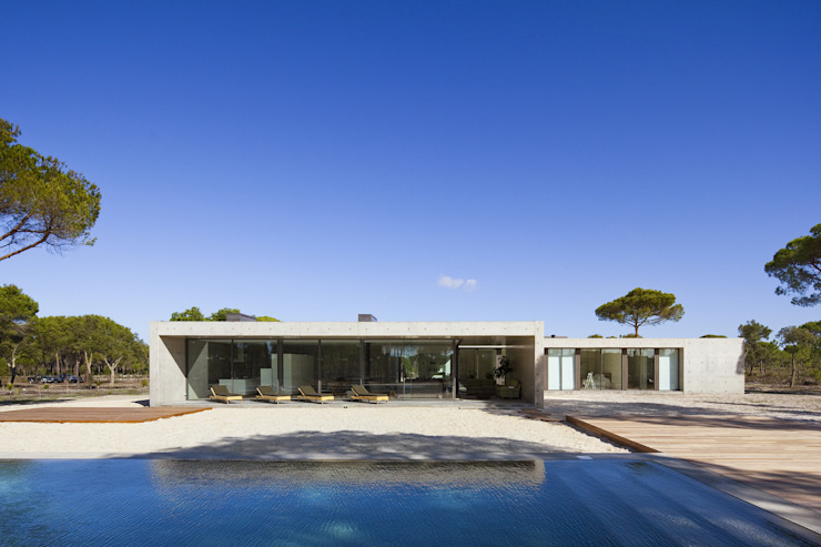 Houses by RRJ Arquitectos, Modern