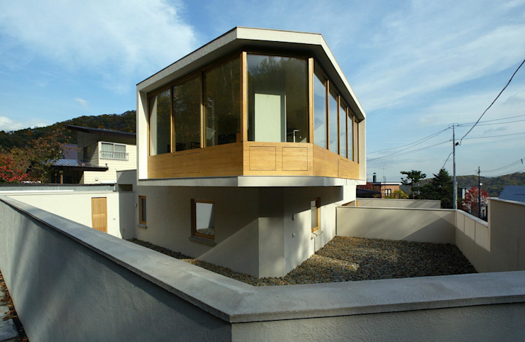 Eclectic style houses by キタウラ設計室 Eclectic