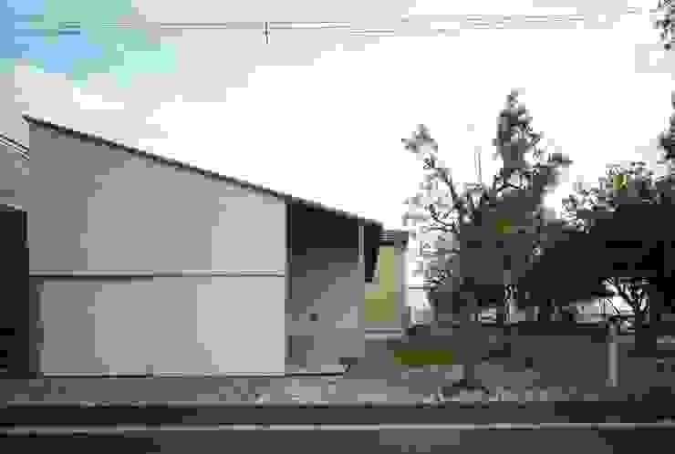 Casas de estilo ecléctico de キタウラ設計室 Ecléctico