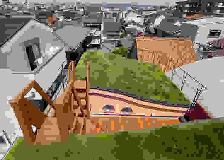 Casas eclécticas de 一級建築士事務所 YURI DESIGN Ecléctico