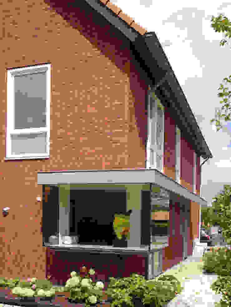 Glazen erker overhoeks. PAA Pattynama Ahaus Architectuur Moderne woonkamers