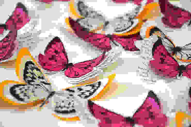 Papillons en papier ancien orange et fuchsia par homify Éclectique