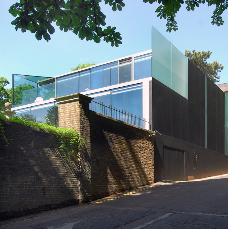 Granite facade to street Casas de estilo minimalista de Eldridge London Minimalista Piedra