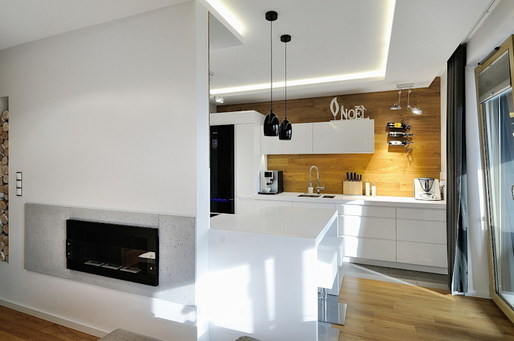 Beton udomowiony – czyli nowoczesne mieszkanie w Krakowie. Nowoczesna kuchnia od ARTEMA PRACOWANIA ARCHITEKTURY WNĘTRZ Nowoczesny