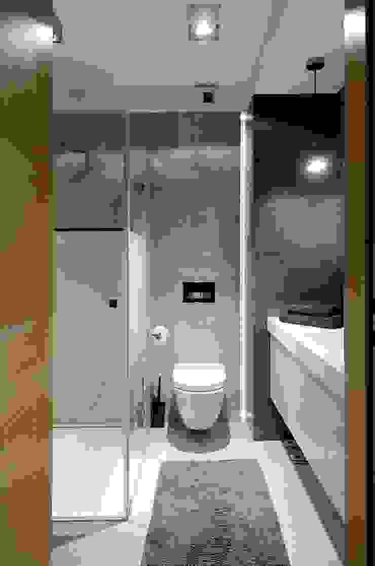 Beton udomowiony – czyli nowoczesne mieszkanie w Krakowie. Nowoczesna łazienka od ARTEMA PRACOWANIA ARCHITEKTURY WNĘTRZ Nowoczesny