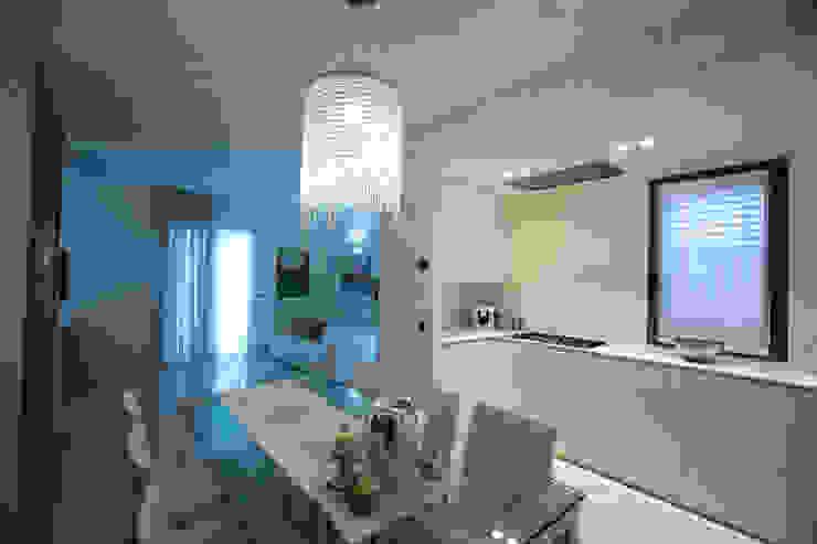 Modern dining room by QUADRASTUDIO Modern