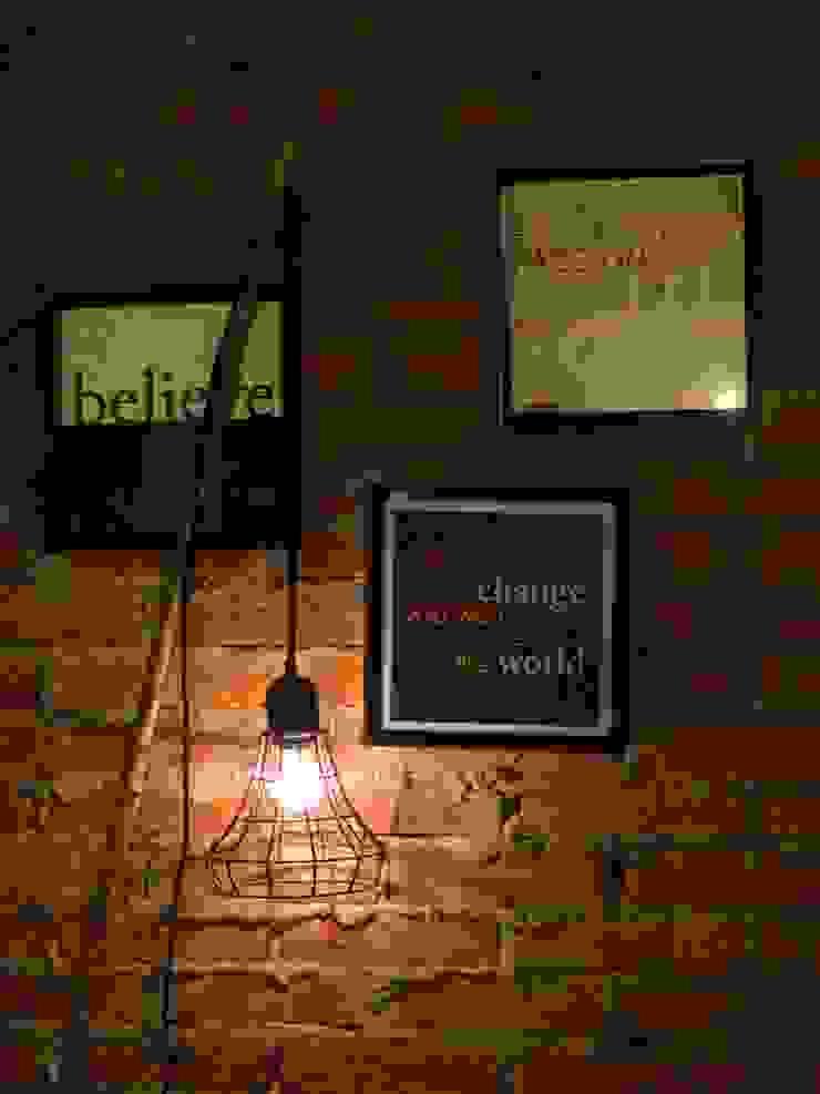 Iluminación romántica:  de estilo industrial por Gaia Design, Industrial