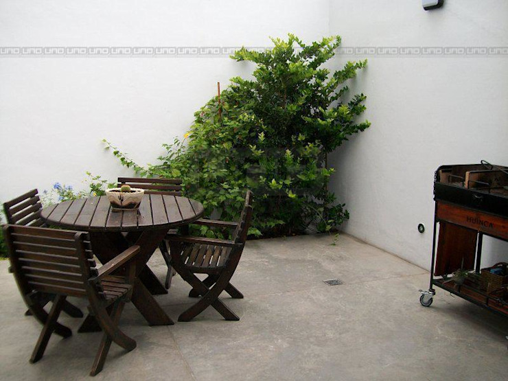 Jardines de estilo  por Uno Propiedades