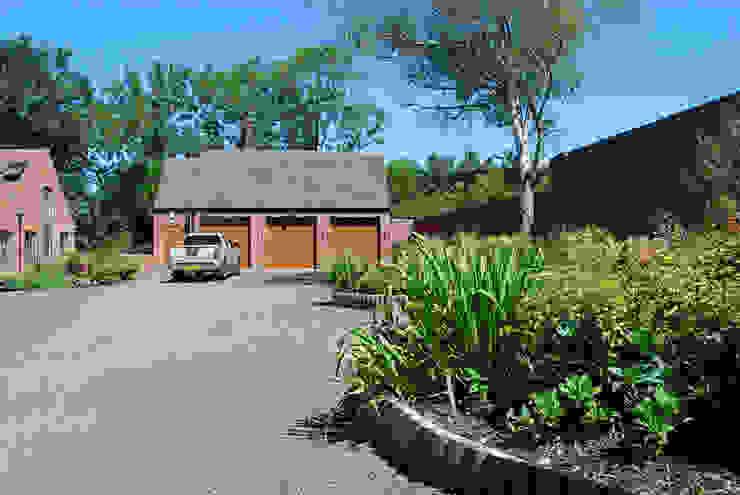 Driveway and garage Lush Garden Design Modern garden