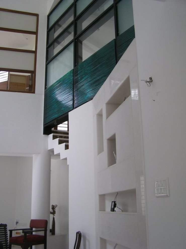 ARUNAGIRI RESIDENCE Modern walls & floors by Muraliarchitects Modern