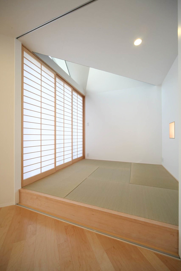 Salas de entretenimiento de estilo minimalista de Spell Design Works Minimalista