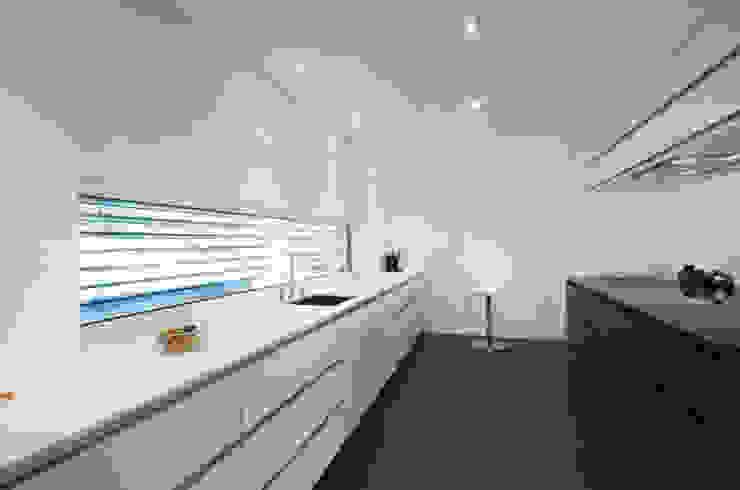 Einfamilienhaus im Schweizer Mittelland Moderne Küchen von Unica Architektur AG Modern