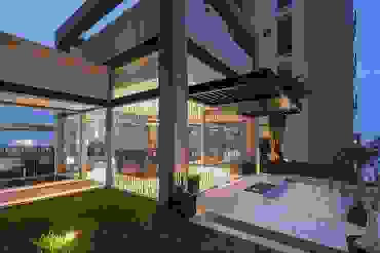 UNUO Interiorismo Eclectic style houses