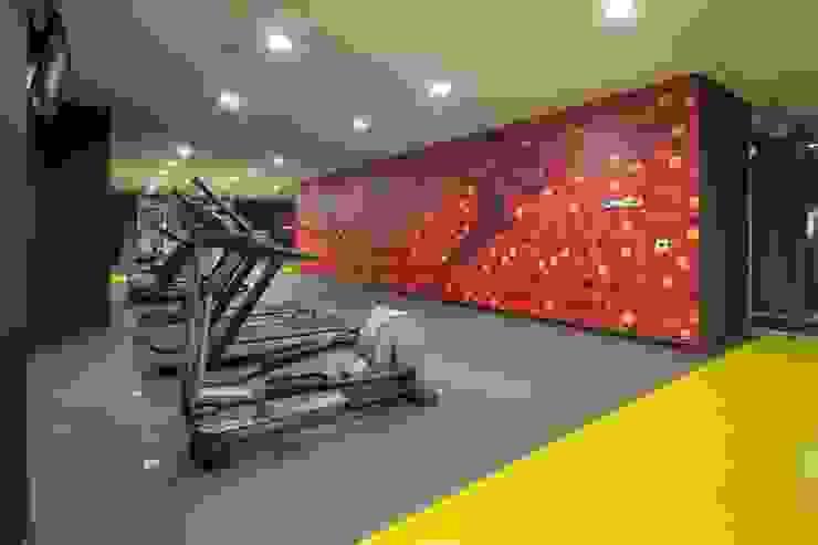 UNUO Interiorismo Eclectic style gym