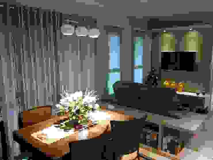 Apartamento Salas multimídia ecléticas por Daiana Pasqualon Arquitetura & Lighting Eclético