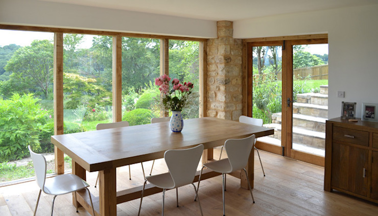 New glazed dining room Modern dining room by homify Modern