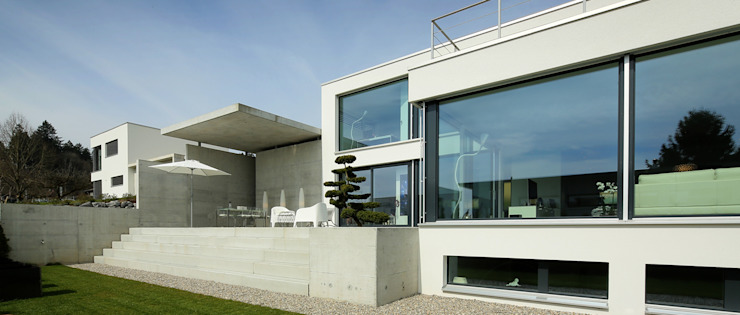 Modern houses by Unica Architektur AG Modern