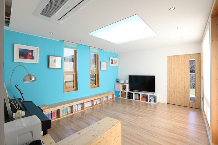 스킵플로어 거실: 주택설계전문 디자인그룹 홈스타일토토의  주택,모던