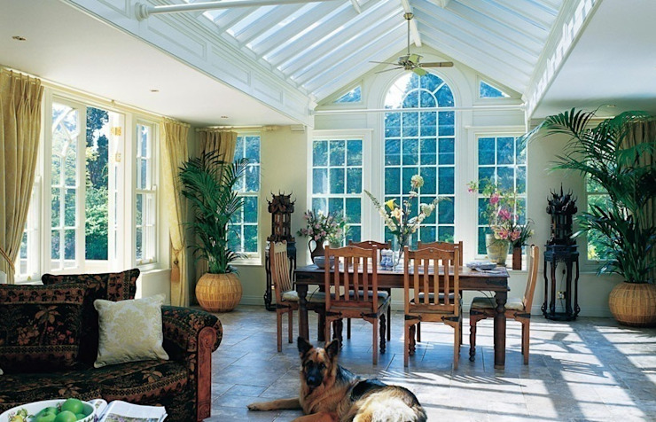 Interior of a bespoke wooden garden room in Bedfordshire Classic style conservatory by Westbury Garden Rooms Classic