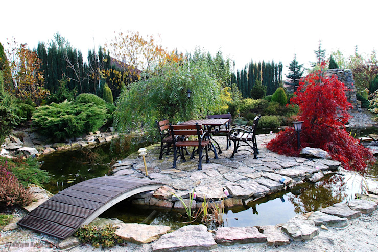 Jardins clássicos por Centrum ogrodnicze Ogrody ResGal Clássico