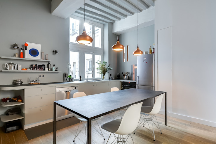 Industrial style dining room by Meero Industrial