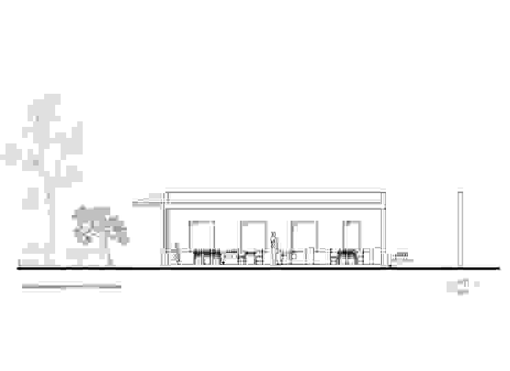 Corte 4 de Komoni Arquitectos Rústico