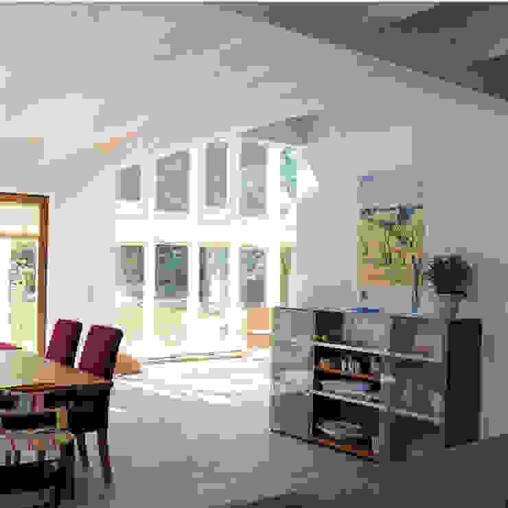 Modern dining room by Dammann-Haus GmbH Modern