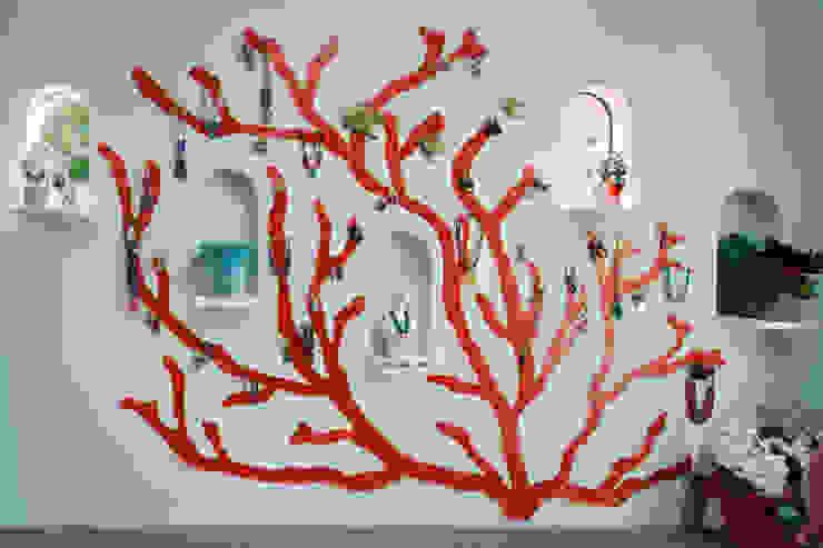 赤珊瑚: 株式会社 藤本高志建築設計事務所が手掛けた壁です。