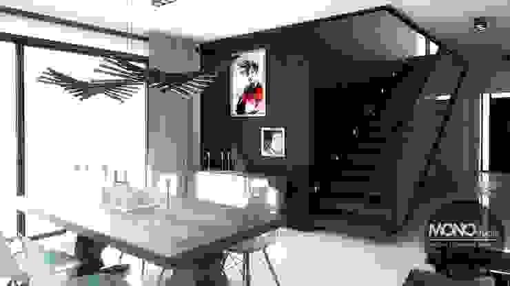 Nowoczesny dom o bardzo ciekawej formie, którego wnętrza korespondują z zewnętrzem. Nowoczesna jadalnia od MONOstudio Nowoczesny